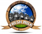 picture of milk  - Wooden round icon or symbol with cans for the transport of milk blue sky and green grass wooden ribbon with text Fresh milk - JPG
