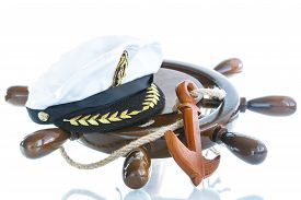 stock photo of anchor  - Decorative wooden ship anchored at the helm on a white background - JPG
