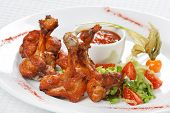 chicken wings with hot spicy barbecue sauce poster