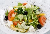 foto of vegetarian meal  - Caesar salad in a white plate - JPG