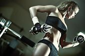 stock photo of weight-lifting  - Young woman weight training - JPG