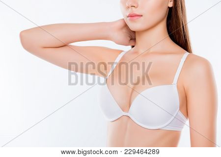 poster of Cropped Close Up Photo Of Beautiful Woman's Breast Clothed In White Classic Bra Cups She Is Touching