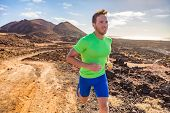 Trail runner running man. Sports and fitness concept. Male athlete ultra running in nature mountain  poster