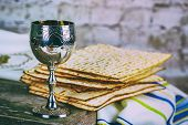 Jewish Matzah On Decorated Silver Wine Cup With Matzah, Jewish Symbols For The Passover Pesach Holid poster