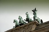 Detail Of The Quadriga Of The Brandenburg Gate, German: Brandenburger Tor, Is A City Gate And One Of poster