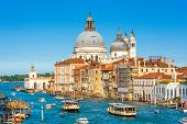 Venice, Italy. Scenic View Of The Grand Canal With Basilica Santa Maria Della Salute And Tourist Boa poster