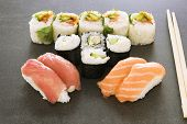 Plate Of Sushi Rolls. Sushi Set Sashimi And Sushi Rolls Served On Wooden Plate. Rolls With Salmon, E poster