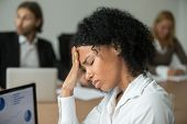 African American Businesswoman Feeling Unwell Suffering From Headache Migraine Touching Forehead At  poster