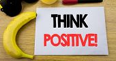 Think Positive. Business Concept For Positivity Attitude Written On Note Empty Paper, Wooden Backgro poster
