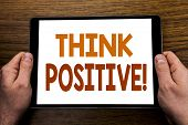 Hand Writing Text Caption Think Positive. Business Concept For Positivity Attitude Written Tablet La poster