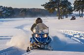 Man On Snowmobile. Recreation Concept On Nature In Winter Holidays. Winter Sports. Driver Of A Snowm poster