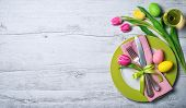 Easter table setting with spring flowers and cutlery. Holidays background poster