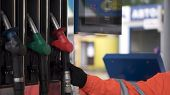 Oil, Fuel Nozzles Hang On The Machine In The Petrol Station. Clip. Close-up Of A Mens Hand Using A  poster