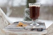 A Cup With A Hot Drink In The Winter Forest. Hot Cocoa With Cinnamon On The Background Of Winter For poster