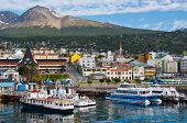 pic of pontoon boat  - Boats line the harbor in Ushuaia southernmost city in the world - JPG