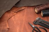 Tools For Leather Crafting And Pieces Of Brown Leather. Manufacture Of Leather Goods. View From Abov poster