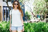 Asian Hipster Girl Long Brown Hair In White Blank T-shirt Is Standing In The Middle Of Street. A Fem poster