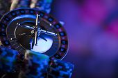 Casino. High contrast image of casino roulette. Poker chips. Bokeh background. poster