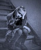 7 Or 8 Years Old Sad Depressed And Worried Schoolgirl Sitting On Staircase Desperate And Scared Suff poster
