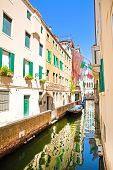 Amazing View To The Narrow Canal In Venice, Italy. Old Buildings Reflect In Green Canal Water. poster