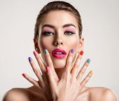 Beautiful fashion woman with a colored nails. Attractive white girl with multicolor manicure. Glamou poster