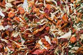 Dried Spices, Sun-dried Tomatoes, Dried Carrots, Basil And Provencal Herbs. Close-up Selective Focus poster