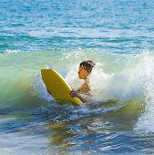 foto of papagayo  - boy has fun surfing in the waves - JPG