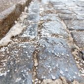 De-icing Chemicals On The Pavement. Pavement Is Sprinkled With Technical Salt Or Salt Mixtures Based poster