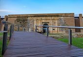 Wooden Flooring On The Bridge Across The Moat. Entrance To The Old Fortress. Historic Building In Eu poster