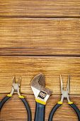 Tools For Master Builder And Accessories On Brown Wooden Vintage Background poster