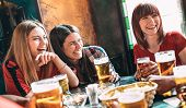 Happy Women Best Friends Drinking Beer At Vintage Bar Restaurant - Female Friendship Concept With Yo poster