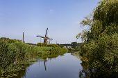 Windmill Farm River Landscape. Windmill Farm Scene. Village Windmill Farm River. Windmill Farm River poster