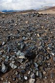 foto of obsidian  - Outcrop of obsidian layer in volcanic rocks