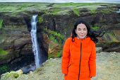 Woman Traveler At Beautiful Scenery Of The Majestic Skogafoss Waterfall In Countryside Of Iceland In poster