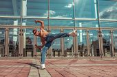 Male Athlete, Jumping Dancing Glass Window Background, Summer City, Hip Hop Style, Break Dancer. Fre poster