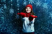 A portrait of a pretty young girl wearing in warm clothes and accessories. Winter fashion for kids,  poster