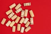 Minimal Trendy Concept With Corks From Wine Bottles On Red Paper Background With Copy Space. Flat La poster