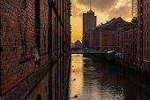 The Brick Architecture Of The Old Buildings With A Water Channel. Speicherstadt, Hamburg, Germany. poster