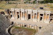 Ancient Antique Amphitheater In The City Of Hierapolis In Turkey. Steps And Antique Statues With Col poster