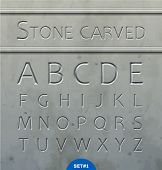 stock photo of rock carving  - Stone carved alphabet - JPG