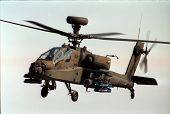 image of longbow  - apache longbow helicopter hovering - JPG