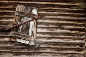 picture of log cabin  - A weathered log cabin background texture with old window - JPG