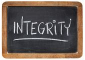 integrity word - white chalk handwriting on a vintage slate blackboard
