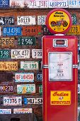 Old license plates and gas pump