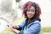 Beautiful Black Woman In Urban Background With Red Hair