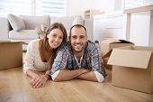 stock photo of house rent  - Young adults moving in new home - JPG