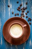 picture of brazilian food  - Coffee cup on a wooden table with beans - JPG
