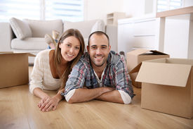 foto of independent woman  - Young adults moving in new home - JPG