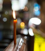 The candle standing on a protection on Walking Street Street in Pattaya on night