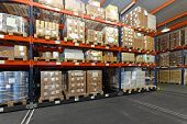 stock photo of racks  - Mobile aisle racking system in distribution warehouse - JPG